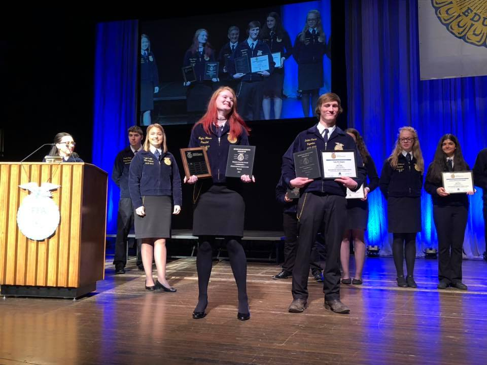 Tully FFA students celebrate on stage after being named the number one FFA chapter in New York State!